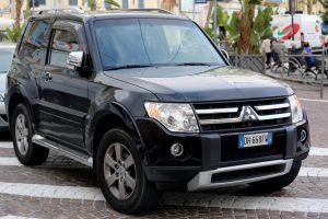 San Remo, Italy - October 16, 2016: Black Mitsubishi Pajero SUV Badly Parked in the Street of San Remo, Italia